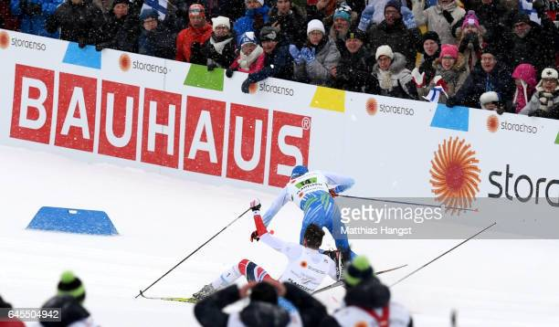 Ivo Niskanen of Finland crashes into Emil Iversen of Norway in the Men's and Women's Cross Country Team Sprint Final during the FIS Nordic World Ski...