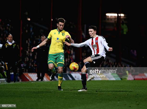 Ivo Pinto of Norwich City and Tom Field of Brentford challenge for the ball during the Sky Bet Championship match between Brentford and Norwich City...