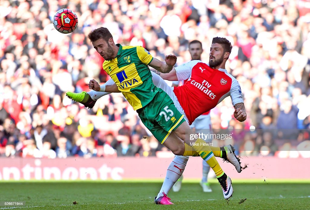 Ivo Pinto of Norwich City clears the ball in front of Olivier Giroud of Arsenal during the Barclays Premier League match between Arsenal and Norwich City at The Emirates Stadium on April 30, 2016 in London, England