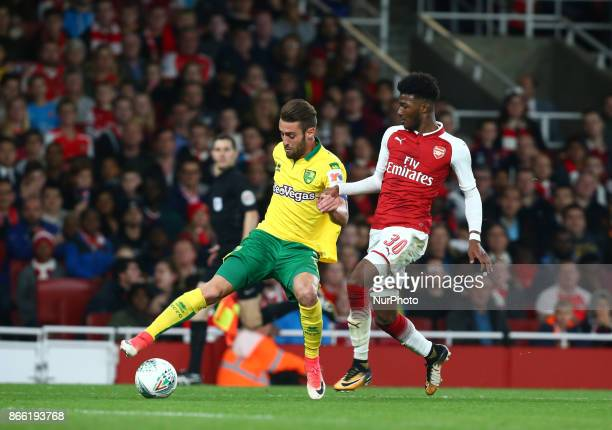 Ivo Pinto of Norwich City holds of Arsenal's Ainsley MaitlandNiles during Carabao Cup 4th Round match between Arsenal and Norwich City at Emirates...