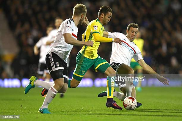 Ivo Pinto of Norwich City is challenged by Kevin McDonald of Fulham during the Sky Bet Championship match between Fulham and Norwich City at Craven...