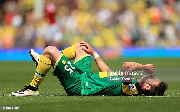 Ivo Pinto of Norwich City lies injured during the Barclays Premier League match between Norwich City and Manchester United at Carrow Road on May 7...