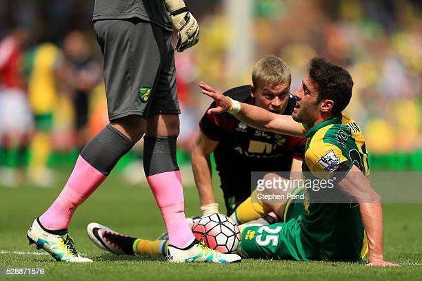 Ivo Pinto of Norwich City receives medical treatment during the Barclays Premier League match between Norwich City and Manchester United at Carrow...