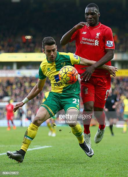 Ivo Pinto of Norwich hilds off a challenge from Christian Benteke of Liverpool during the Barclays Premier League match between Norwich City and...