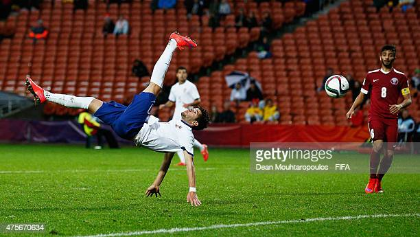 Ivo Rodrigues of Portugal shoots and scores an overhead or bicycle kick for the second goal of the game past goalkeeper Youssef Hassan of Qatar...