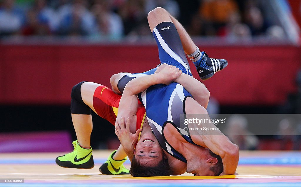 Ivo Serafimov Angelov of Bulgaria competes against Jiang Sheng of China (L) during the Men's Greco-Roman 60 kg Wrestling Repechage on Day 10 of the London 2012 Olympic Games at ExCeL on August 6, 2012 in London, England.