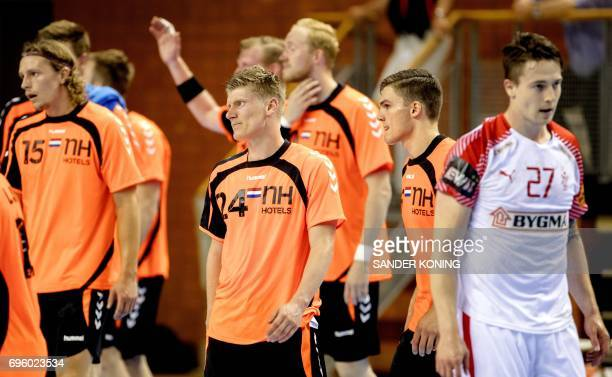 Ivo Steins and Luc Steins of The Netherlands react after the losing their EC qualification handball match in Almere on June 14 2017 / AFP PHOTO / ANP...