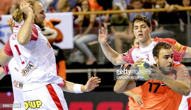 Ivo Steins of The Netherlands holds the ball during the EC qualification handball match Denmark vs Netherlands in Almere on June 14 2017 / AFP PHOTO...