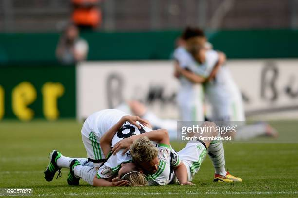 Ivonne Hartmann and Lena Goessling of Wolfsburg celebrate after winning the Women's DFB Cup Final between VfL Wolfsburg and 1 FFC Turbine Potsdam at...