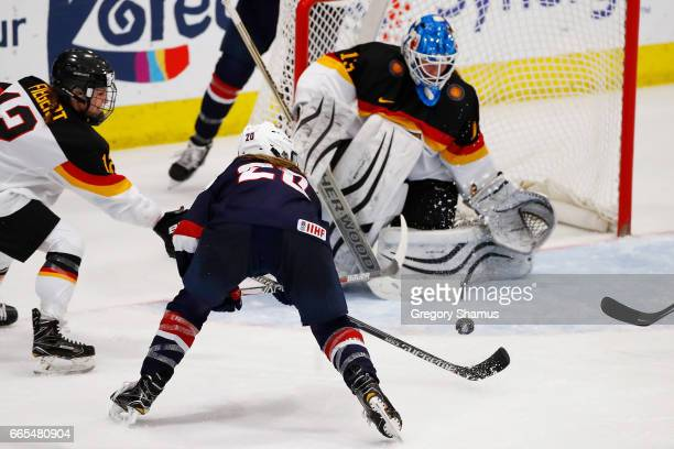 Ivonne Schroder of Germany makes a thirdperiod save on a shot by Hannah Brandt of the United States during a semifinal game at the 2017 IIHF Woman's...