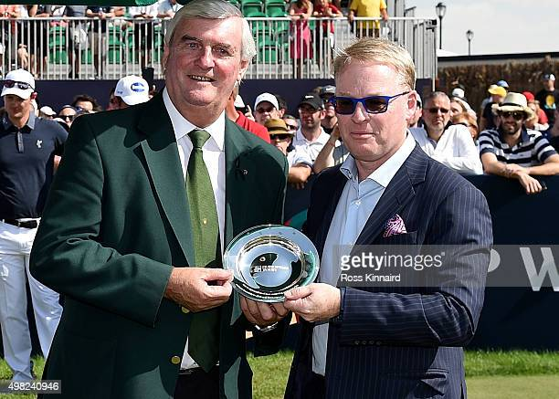 Ivor Robson the offical starter of the European Tour is presented with a silver salver by Keith PelleyChief Executive Officer of the European Tour...