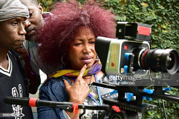 Ivorian actress director and show creator Akissi Delta looks through a camera at a film set during the shooting of the television series 'Ma Famille'...
