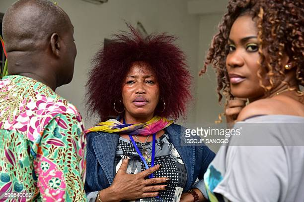 Ivorian actress director and show creator Akissi Delta speaks at a film set during the shooting of the television series 'Ma Famille' in Abidjan on...