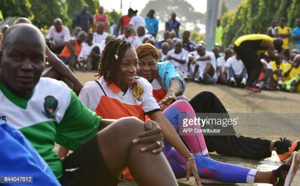 Ivorian athlet MarieJosee TaLou performs a warmup exercice as she takes part in the 'Ivorian army cohesion day' on September 8 2017 in Abidjan / AFP...