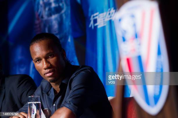 Ivorian football star Didier Drogba attends a press conference to announce his move to Shanghai Shenhua FC at RitzCarlton Hotel on July 14 2012 in...