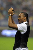 Ivorian football star Didier Drogba greets Shanghai Shenhua FC fans at Hongkou Soccer Stadium on July 14 2012 in Shanghai China Drogba signed a...