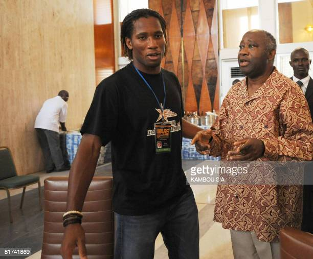 Ivorian international star soccer player Didier Drogba talks with Ivorian President Laurent Gbagbo during an event for the African Stars Galaxya...