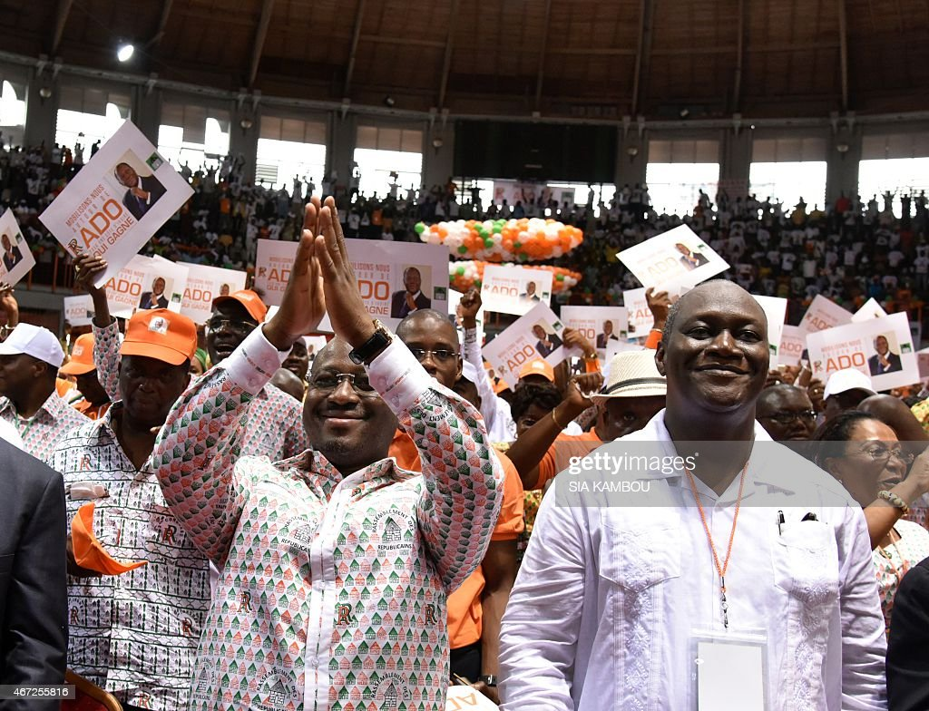 Ivorian national assembly president <a gi-track='captionPersonalityLinkClicked' href=/galleries/search?phrase=Guillaume+Soro&family=editorial&specificpeople=697567 ng-click='$event.stopPropagation()'>Guillaume Soro</a> (foreground L) and state minister Ibrahim Ouattara take part in the congress of the 'Rassemblement des Republicains' party (RDR) for the investiture as presidential candidate of incumbent Ivorian president Alassane Ouatarra, on March 22, 2015 in Abidjan . AFP PHOTO/ SIA KAMBOU
