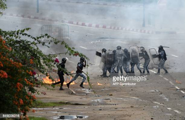 Ivorian police officers move in formation during clashes with protesting students within a demonstration against rising education costs at the Felix...