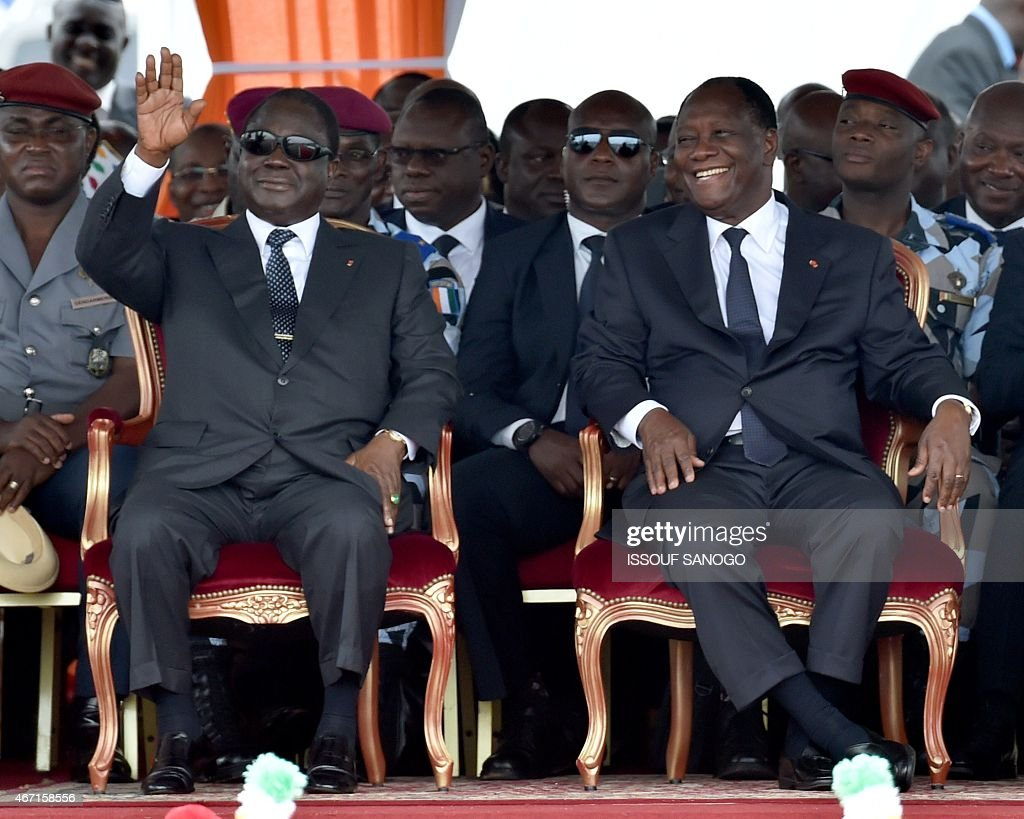 Ivorian president <a gi-track='captionPersonalityLinkClicked' href=/galleries/search?phrase=Alassane+Ouattara&family=editorial&specificpeople=697562 ng-click='$event.stopPropagation()'>Alassane Ouattara</a> (R) and former president <a gi-track='captionPersonalityLinkClicked' href=/galleries/search?phrase=Henri+Konan+Bedie&family=editorial&specificpeople=697544 ng-click='$event.stopPropagation()'>Henri Konan Bedie</a> attend the ceremony marking the inauguration of the Philippe Gregoire Yace bridge, on March 21, 2015 in Abidjan.