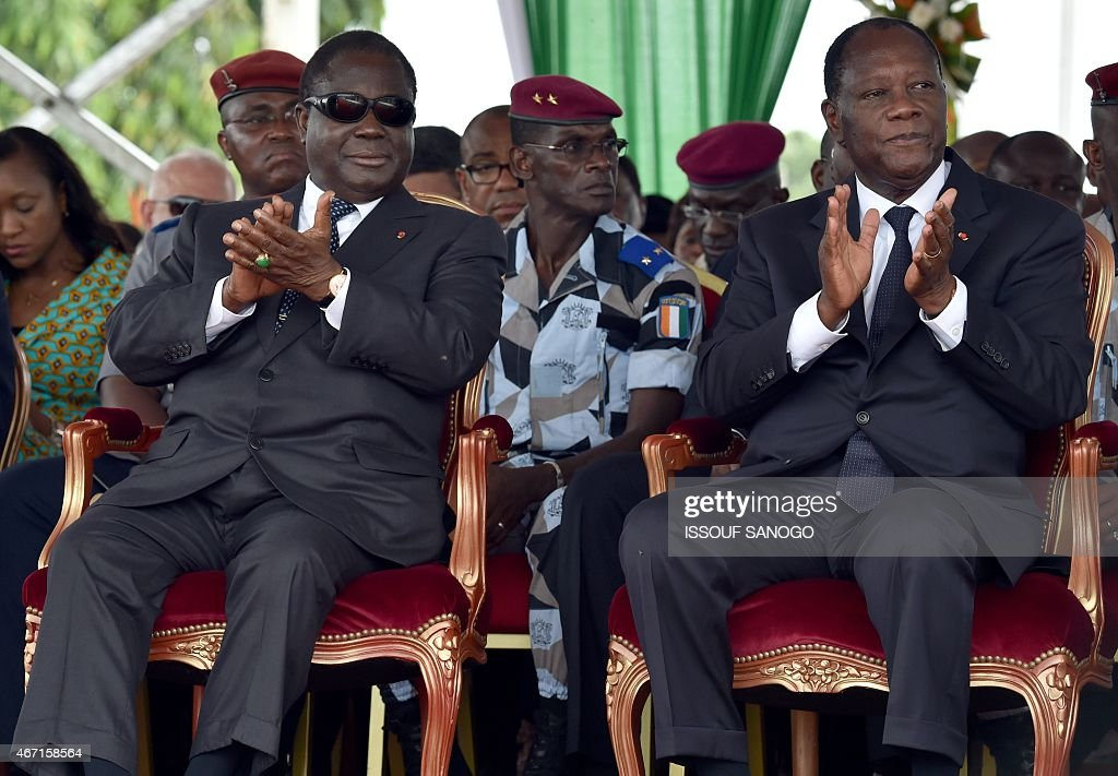 Ivorian president <a gi-track='captionPersonalityLinkClicked' href=/galleries/search?phrase=Alassane+Ouattara&family=editorial&specificpeople=697562 ng-click='$event.stopPropagation()'>Alassane Ouattara</a> (R) and former president <a gi-track='captionPersonalityLinkClicked' href=/galleries/search?phrase=Henri+Konan+Bedie&family=editorial&specificpeople=697544 ng-click='$event.stopPropagation()'>Henri Konan Bedie</a> applaud as they attend the ceremony marking the inauguration of the Philippe Gregoire Yace bridge, on March 21, 2015 in Abidjan.