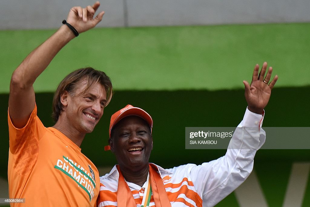 Ivorian President <a gi-track='captionPersonalityLinkClicked' href=/galleries/search?phrase=Alassane+Ouattara&family=editorial&specificpeople=697562 ng-click='$event.stopPropagation()'>Alassane Ouattara</a> (R) and Ivory Coast's national football team coach <a gi-track='captionPersonalityLinkClicked' href=/galleries/search?phrase=Herve+Renard&family=editorial&specificpeople=2789238 ng-click='$event.stopPropagation()'>Herve Renard</a> wave at the crowd during a welcoming ceremony at Felix Houphouet Boigny Stadium in Abidjan on February 9, 2015, a day after Ivory Coast won the 2015 African Cup of Nations football tournament. Ivory Coast ended a 23-year Africa Cup of Nations title drought by winning 9-8 on penalties against Ghana.