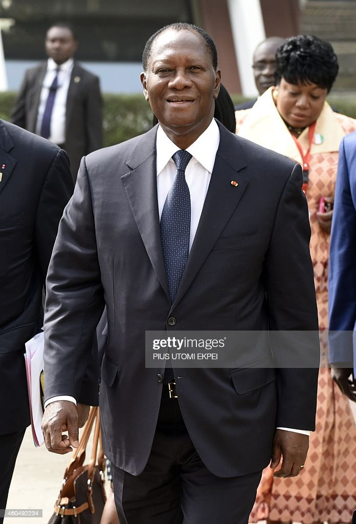 Ivorian President <a gi-track='captionPersonalityLinkClicked' href=/galleries/search?phrase=Alassane+Ouattara&family=editorial&specificpeople=697562 ng-click='$event.stopPropagation()'>Alassane Ouattara</a> arrives to attend the Summit of ECOWAS Heads of state and government in Abuja on December 15, 2014. Heads of states and government of ECOWAS are meeting in Abuja to discuss the on-going fight against the deadly Ebola virus disease that is ravaging the region, as well as the political and security situation in the region.