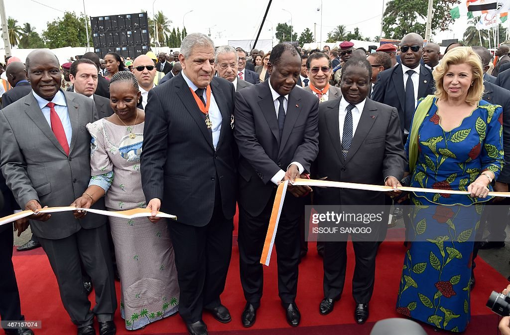 Ivorian president <a gi-track='captionPersonalityLinkClicked' href=/galleries/search?phrase=Alassane+Ouattara&family=editorial&specificpeople=697562 ng-click='$event.stopPropagation()'>Alassane Ouattara</a> (3rdR) cuts the ribbon next to (LtoR) Ivorian Prime minister Daniel Kablan Duncan, Great Chancellor of Ivorian National Order Henriette Diabate, Egyptian Prime minister Ibrahim Mahlab former Ivorian president <a gi-track='captionPersonalityLinkClicked' href=/galleries/search?phrase=Henri+Konan+Bedie&family=editorial&specificpeople=697544 ng-click='$event.stopPropagation()'>Henri Konan Bedie</a> and Ivorian first lady Dominique Ouattara during the inauguration of the Philippe Gregoire Yace bridge , on March 21, 2015 in Abidjan.
