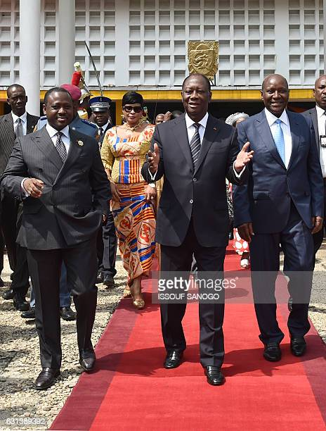 Ivorian President Alassane Ouattara flanked by newly reelected Ivorian National Assembly president Guillaume Soro and former Ivorian prime minister...