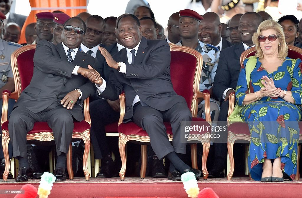 Ivorian president <a gi-track='captionPersonalityLinkClicked' href=/galleries/search?phrase=Alassane+Ouattara&family=editorial&specificpeople=697562 ng-click='$event.stopPropagation()'>Alassane Ouattara</a> (C) shakes hands with former president <a gi-track='captionPersonalityLinkClicked' href=/galleries/search?phrase=Henri+Konan+Bedie&family=editorial&specificpeople=697544 ng-click='$event.stopPropagation()'>Henri Konan Bedie</a> as they attend the ceremony marking the inauguration of the Philippe Gregoire Yace bridge, on March 21, 2015 in Abidjan.