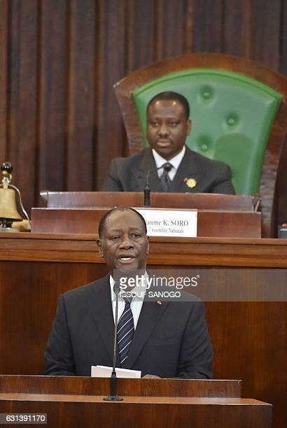 Ivorian President Alassane Ouattara speaks and newly reelected Ivorian National Assembly president Guillaume Soro listens on January 10 2017 at the...