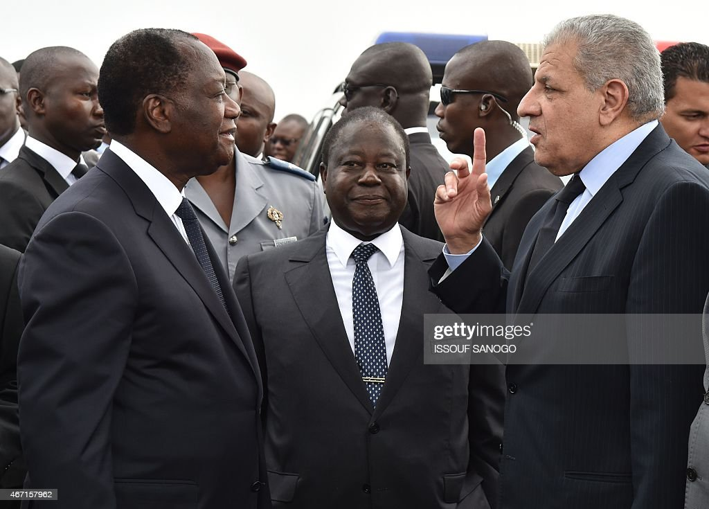 Ivorian president <a gi-track='captionPersonalityLinkClicked' href=/galleries/search?phrase=Alassane+Ouattara&family=editorial&specificpeople=697562 ng-click='$event.stopPropagation()'>Alassane Ouattara</a> (L) speaks with former Ivorian president <a gi-track='captionPersonalityLinkClicked' href=/galleries/search?phrase=Henri+Konan+Bedie&family=editorial&specificpeople=697544 ng-click='$event.stopPropagation()'>Henri Konan Bedie</a> (C) and Egyptian Prime minister Ibrahim Mahlab (R) during the inauguration of the Philippe Gregoire Yace bridge, on March 21, 2015 in Abidjan.