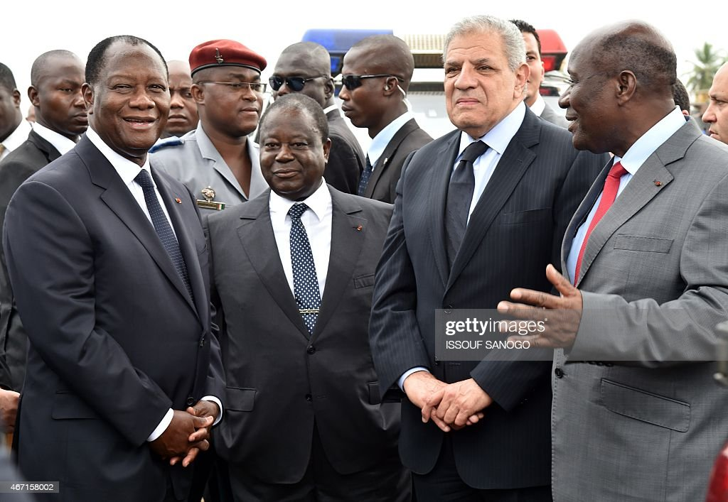 Ivorian president <a gi-track='captionPersonalityLinkClicked' href=/galleries/search?phrase=Alassane+Ouattara&family=editorial&specificpeople=697562 ng-click='$event.stopPropagation()'>Alassane Ouattara</a> (L) speaks with former Ivorian president <a gi-track='captionPersonalityLinkClicked' href=/galleries/search?phrase=Henri+Konan+Bedie&family=editorial&specificpeople=697544 ng-click='$event.stopPropagation()'>Henri Konan Bedie</a> (2ndL), Egyptian Prime minister Ibrahim Mahlab (2ndR) and Ivorian Prime minister Daniel Kablan Duncan (R) during the inauguration of the Philippe Gregoire Yace bridge, on March 21, 2015 in Abidjan.