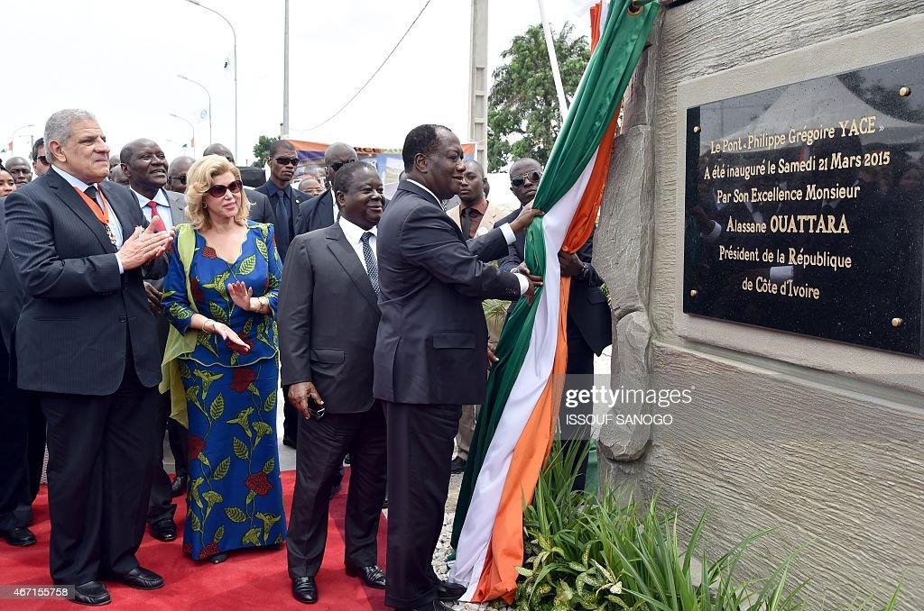 Ivorian president <a gi-track='captionPersonalityLinkClicked' href=/galleries/search?phrase=Alassane+Ouattara&family=editorial&specificpeople=697562 ng-click='$event.stopPropagation()'>Alassane Ouattara</a> (R) unveil a plaque eyed by former Ivorian president <a gi-track='captionPersonalityLinkClicked' href=/galleries/search?phrase=Henri+Konan+Bedie&family=editorial&specificpeople=697544 ng-click='$event.stopPropagation()'>Henri Konan Bedie</a> (C) and Egyptian Prime minister Ibrahim Mahlab (L) during the inauguration of the Philippe Gregoire Yace bridge , on March 21, 2015 in Abidjan. AFP PHOTO ISSOUF SANOGO
