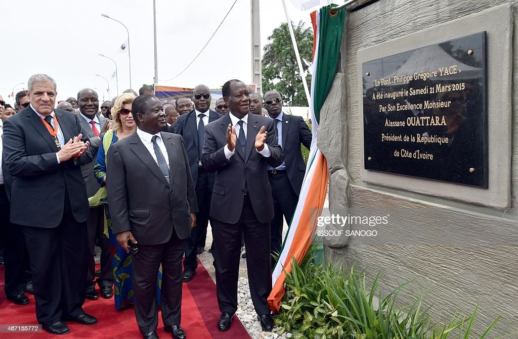 Ivorian president <a gi-track='captionPersonalityLinkClicked' href=/galleries/search?phrase=Alassane+Ouattara&family=editorial&specificpeople=697562 ng-click='$event.stopPropagation()'>Alassane Ouattara</a> (R) unveil a plaque eyed by former Ivorian president <a gi-track='captionPersonalityLinkClicked' href=/galleries/search?phrase=Henri+Konan+Bedie&family=editorial&specificpeople=697544 ng-click='$event.stopPropagation()'>Henri Konan Bedie</a> (C) and Egyptian Prime minister Ibrahim Mahlab (L) during the inauguration of the Philippe Gregoire Yace bridge , on March 21, 2015 in Abidjan.