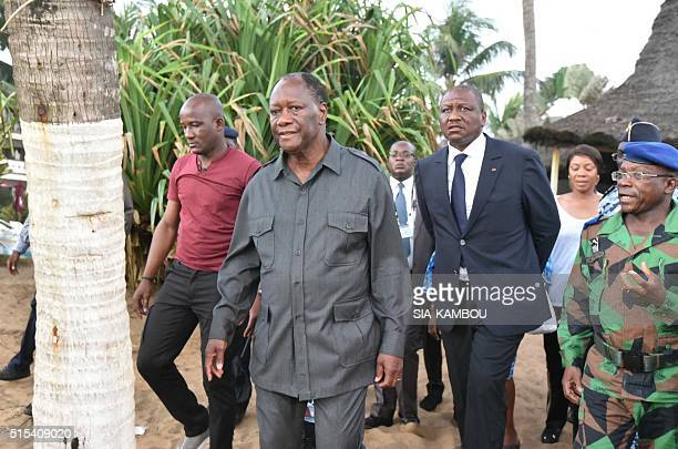 Ivorian president Alassane Ouattara visits the beach resort of GrandBassam after gunmen went on a shooting rampage in three hotels on March 13 2016...