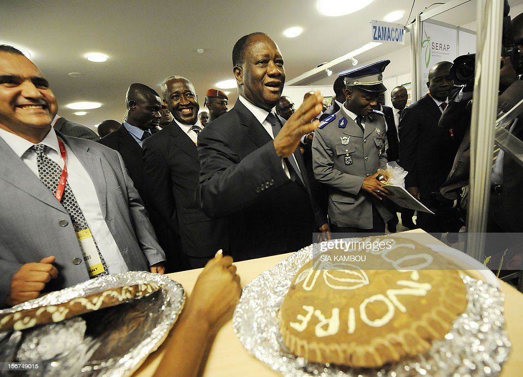 Ivorian President Alassane Ouattara walks past chocolate cakes after the opening ceremony of the 2012 World Cocoa conference in Abidjan. Ivory Coast on Tuesday hosts world players in the cocoa business for a conference on how to face up to the challenges posed by soaring demand.
