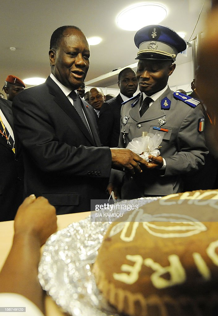 Ivorian President Alassane Ouattara (L) walks past chocolate cakes after the opening ceremony of the 2012 World Cocoa conference in Abidjan. Ivory Coast on Tuesday hosts world players in the cocoa business for a conference on how to face up to the challenges posed by soaring demand.