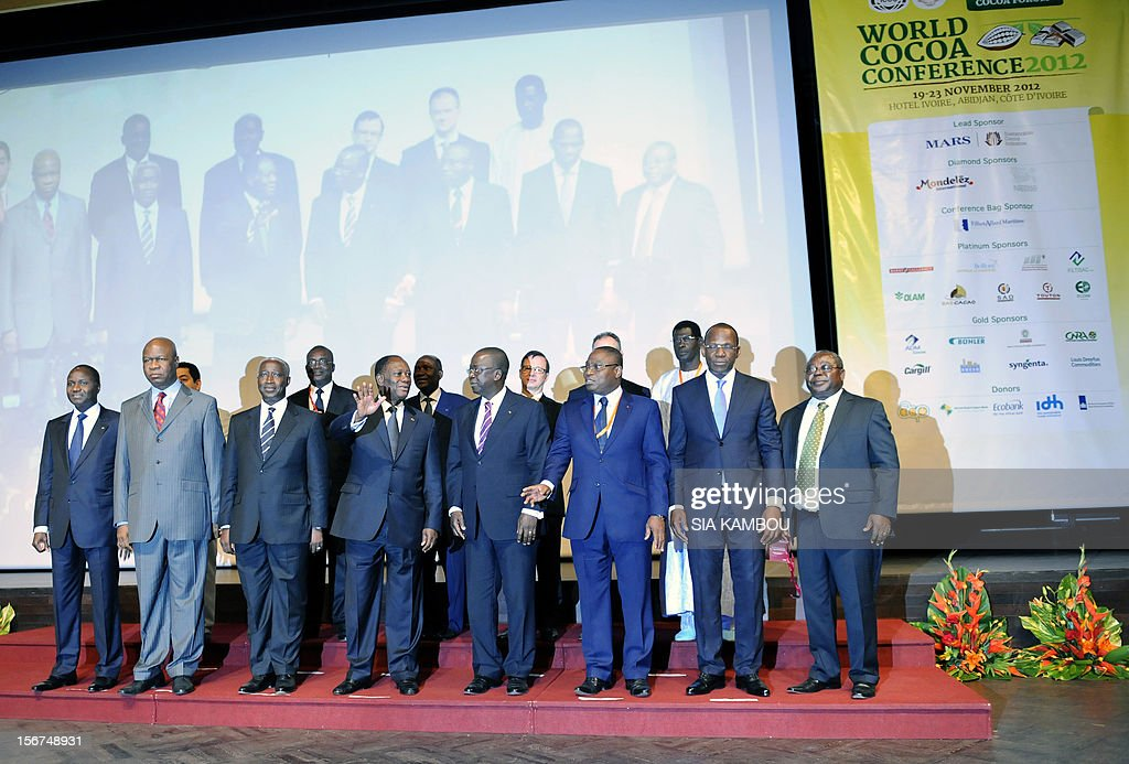 Ivorian President Alassane Ouattara (C) waves on stage among participants during the 2012 World Cocoa conference in Abidjan. Ivory Coast on Tuesday hosts world players in the cocoa business for a conference on how to face up to the challenges posed by soaring demand.
