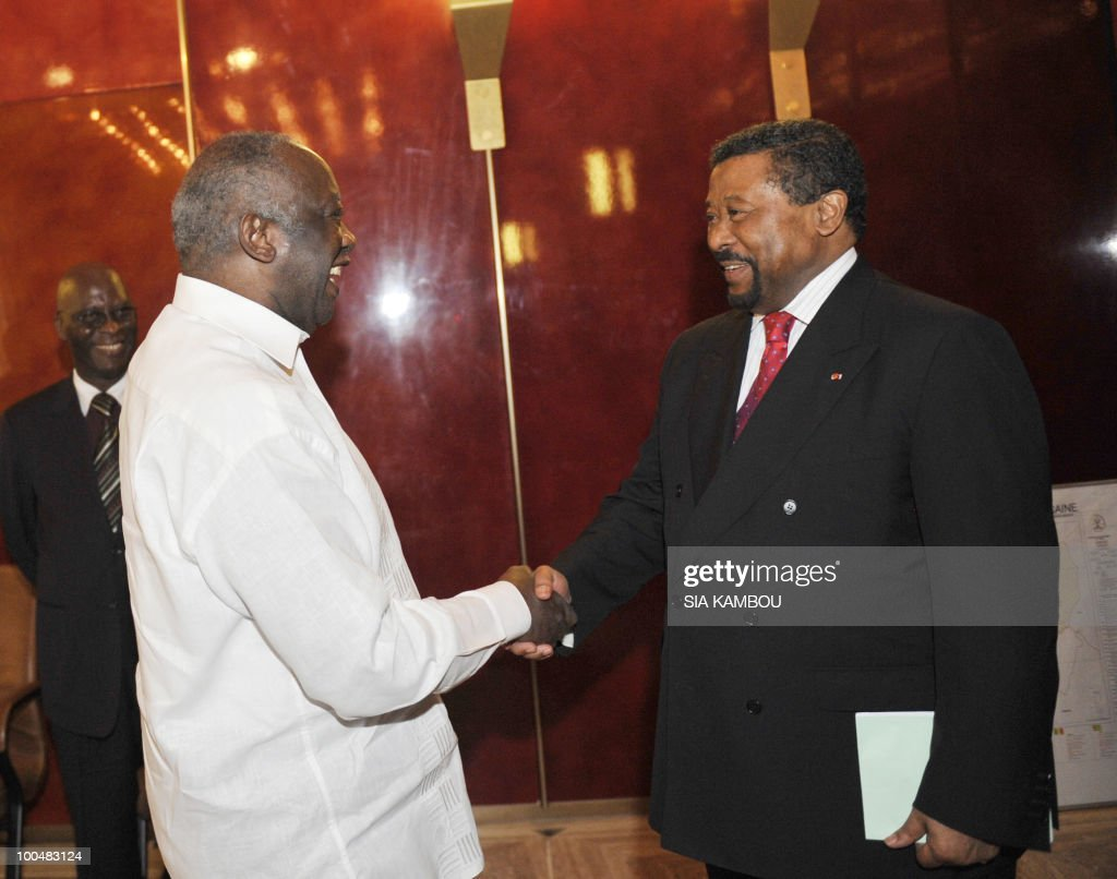 Ivorian President Laurent Gbagbo (L) shakes hands with African Union (AU) chief Jean Ping (R) on May 24, 2010 at the Presidential Palace in Abidjan before their talks focused on the African Development Bank annual meetings due to be held on May 27 and 28, 2010 in Abidjan.