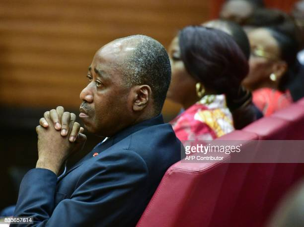 Ivorian Prime Minister Amadou Gon Coulibaly looks on during the signing of an accord between the Ivorian Public Service Minister and the...