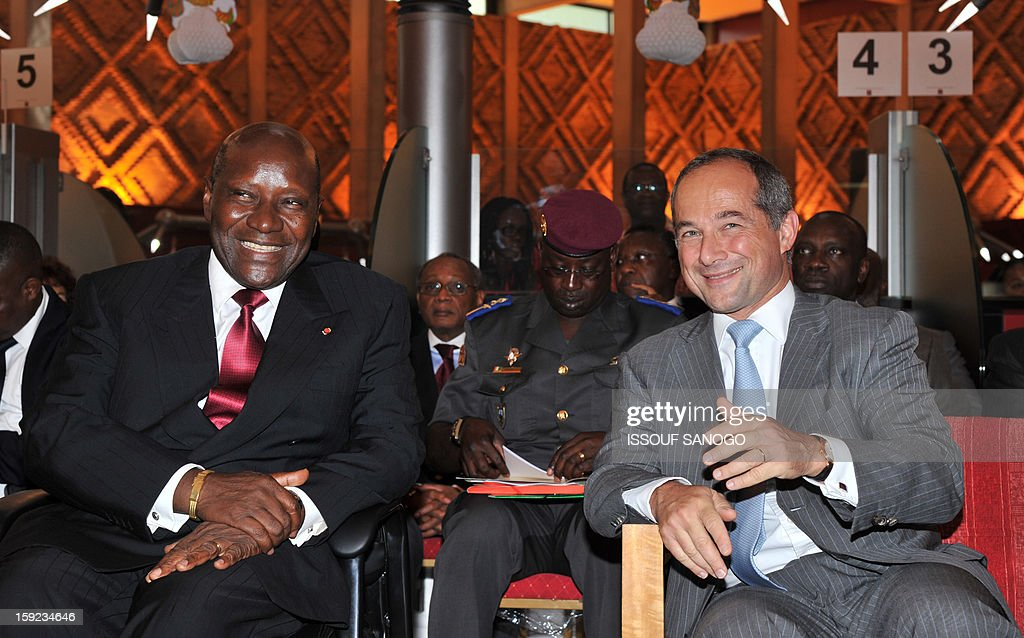 Ivorian Prime Minister Daniel Kablan Duncan (L) listens on January 10, 2013 to the chief executive officer of French bank Societe Generale, Frederic Oudea (R), in Abidjan during events marking the 50th anniversary of Societe General in Ivory Coast (SGBCI).