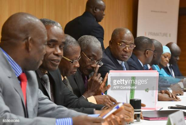 Ivorian Public Service Minister Issa Coulibaly looks on as union leaders sign an agreement between the Ivorian government and the trade unions in...