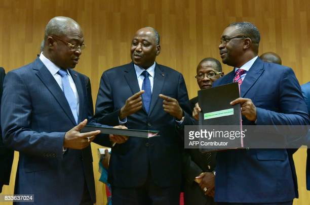Ivorian Public Service Minister Issa Coulibaly secretarygeneral of the InterUnion of Civil Servants of the Ivory Coast Theodore Zadi Gnagna exchange...
