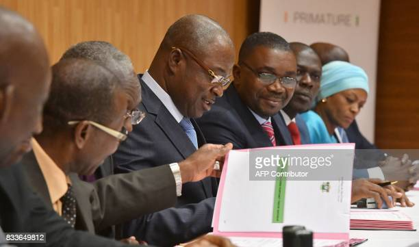 Ivorian Public Service Minister Issa Coulibaly signs with other union leaders an accord between the Ivorian government and the trade unions in...