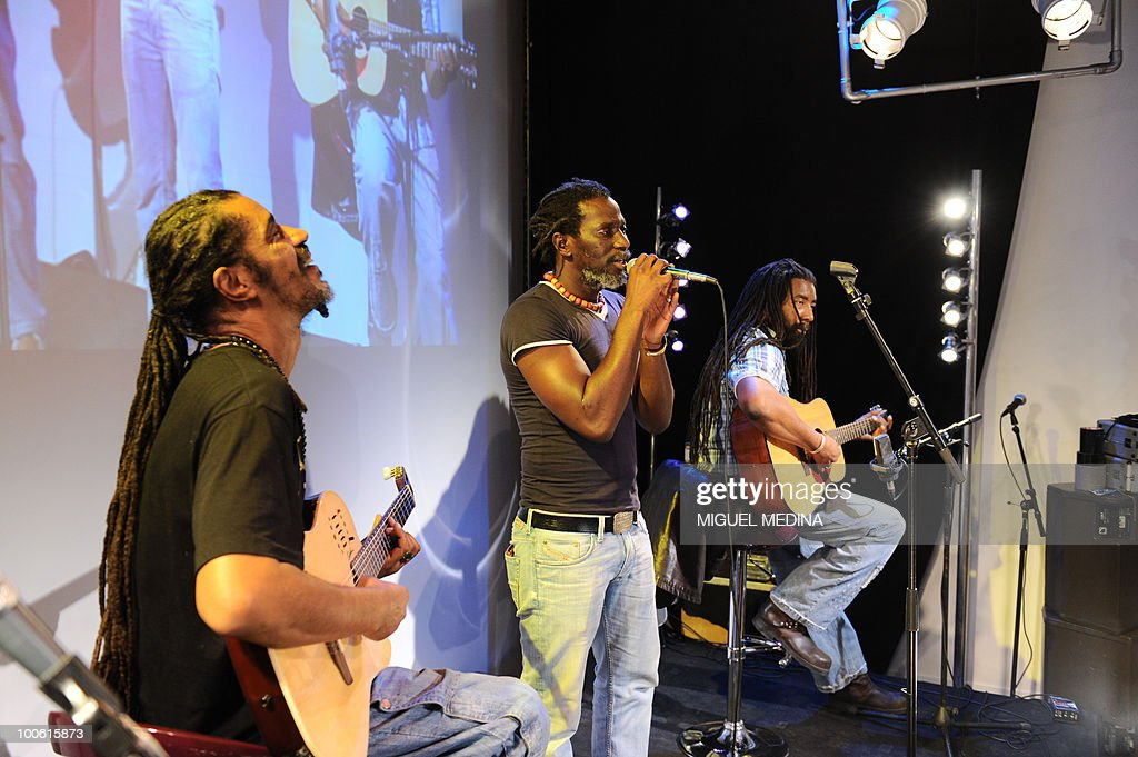 Ivorian singer Tiken Jah Fakoly (C) performs on stage during the launching of 'TV5Monde+Afrique', an internet TV offering entirely dedicated to all things African on May 25, 2010 in Paris. Targeting the African diaspora, and all the people loving this continent, the TV5Monde+Afrique, launched by TV5Monde, is free and accessible worldwide with the exception of the UK and Ireland because of distribution issues.