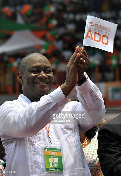 Ivorian state minister Ibrahim Ouattara applauds a speech during the 'Rassemblement des Republicains' party congress for the investiture as...