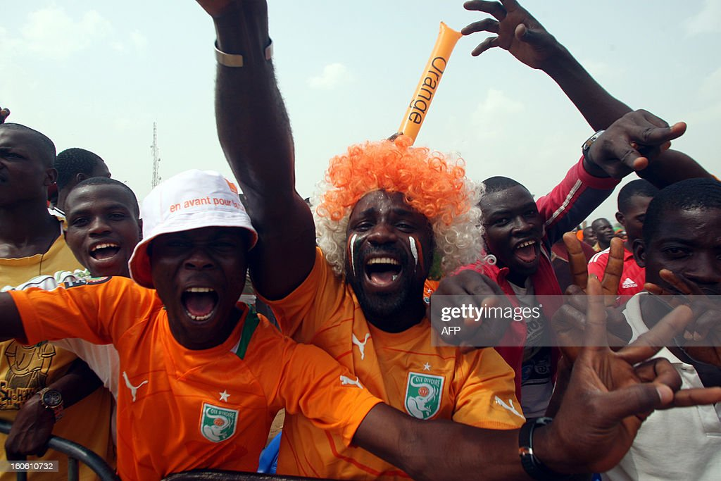 Ivorian supporters react, on February 3, 2013 in the Yopougon district in Abidjan, as they watch on a big screen the African Cup of Nation 2013 quarter final football match Ivory Coast vs Nigeria, in Rustenburg. Supposed underdogs Nigeria downed favourites Ivory Coast 2-1 in Rustenburg today, in an absorbing Africa Cup of Nations quarter-final to set up a last-four meeting with Mali. AFP PHOTO HERVE SEVI