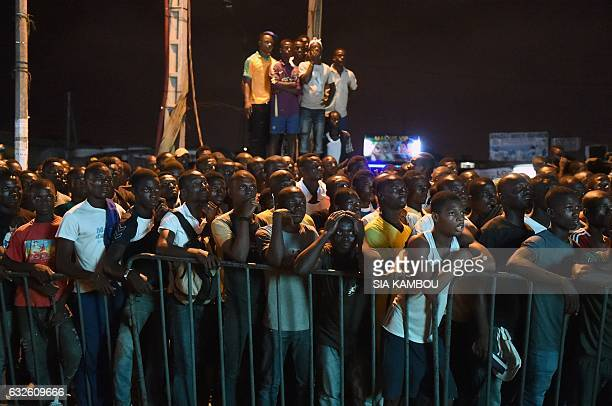 TOPSHOT Ivorian supporters watch on a giant screen the 2017 Africa Cup of Nations group C football match between Morocco and Ivory Coast in Abidjan...