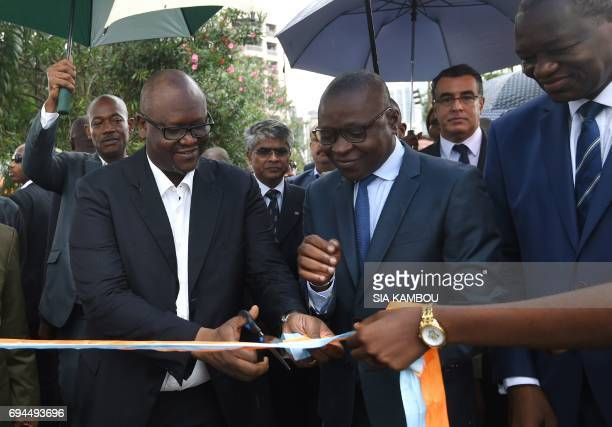 Ivorian Transport Minister Amadou Kone and director of the vorian Transport Company Zoumana Bakayoko cut a ribbon during a ceremony to inaugurate...